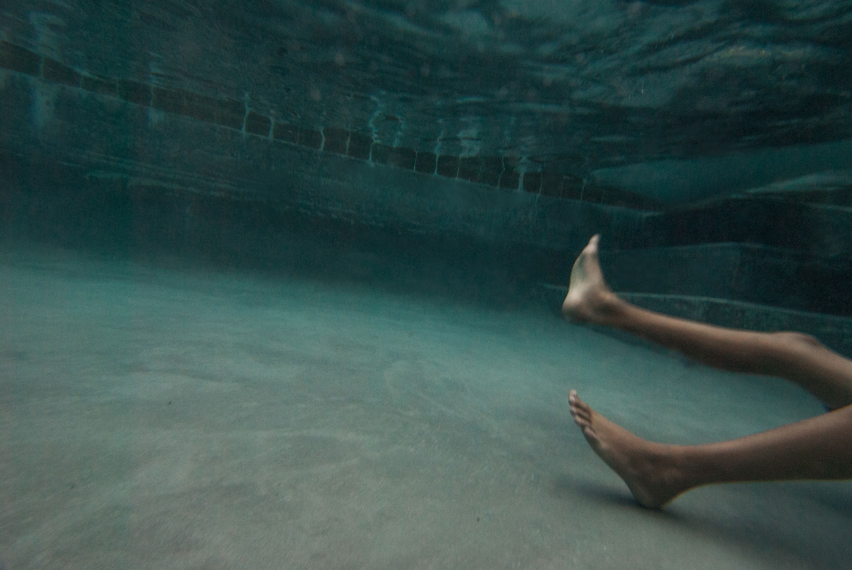 Feet at the Bottom of Pool