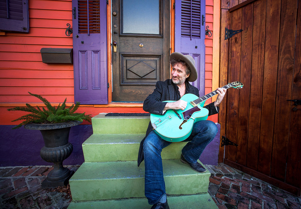 Jon Cleary Playing Guitar New Orleans Stairs